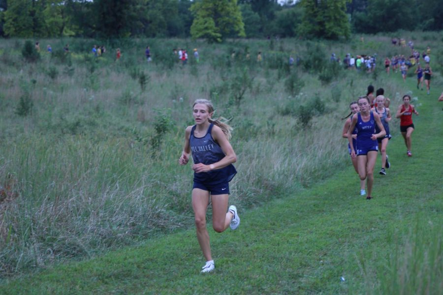 Rounding the corner of the course, senior Bridget Roy completes the first mile of the race.
