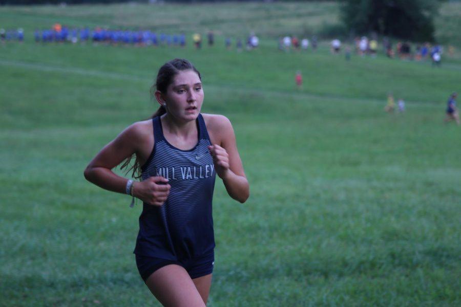 With 800 meters left in the race, sophomore Kynley Verdict looks ahead.