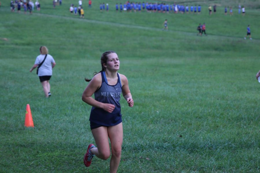 Eyes up, sophomore Ellie Walker paces herself for the second mile of the 5k race.