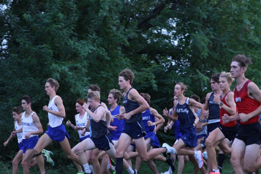 Starting off the race, the varsity boys team sprints out of the shoot dispersing themselves amongst other runners. The boys team took third overall at the Greg Wilson Classic on Thursday, September 2.