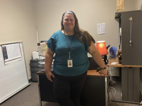 After being hired on late in the summer, new assistant band director Jennifer Whyte stands in front of her desk.
