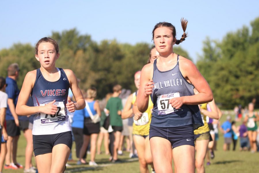 Looking upwards, senior Logan Pfiester concentrates on what is left of the course.