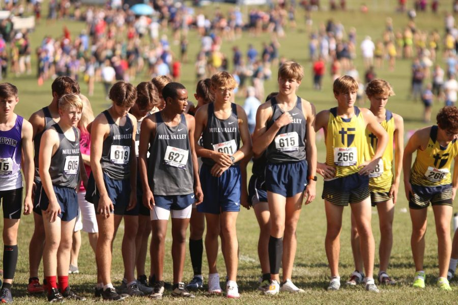 Before they are told to take their marks, the boys team stands with one another in the starting chute.
