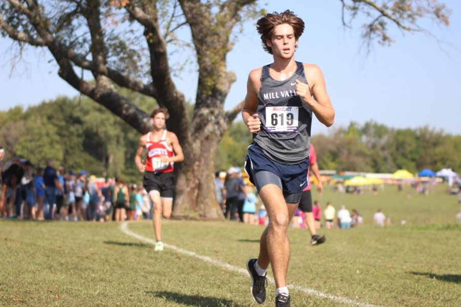 Looking to the corner of the course, senior Chase Schieber runs around the bend. Schieber went on to secure a time of 16:32 finishing in  fifth place.