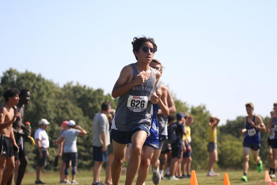 Turning the corner, freshman Yazid Vazquez focuses on what is ahead of him.