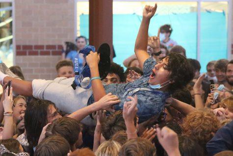 Hoisted in the air by his classmates, senior Danny Talavera crowd surfs.