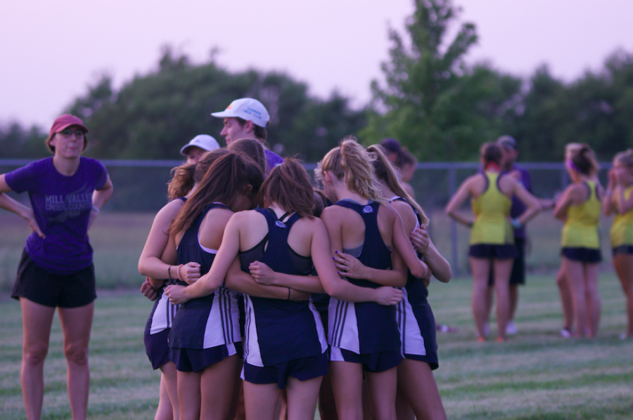 Before reporting to the chute for the start of their race, the JV girls team huddles together.