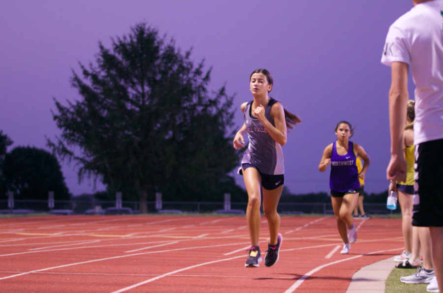 On the last straightaway, freshman Isabel Cherrito sprints out the last 100 meters of the 5K.