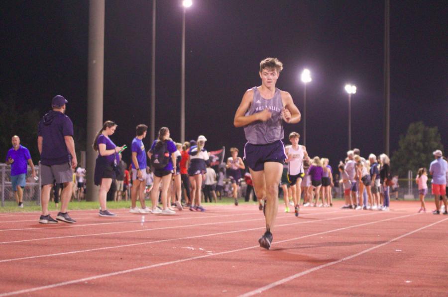 Junior Ollie Taylor focuses on the course ahead of him to finish the boys JV race.
