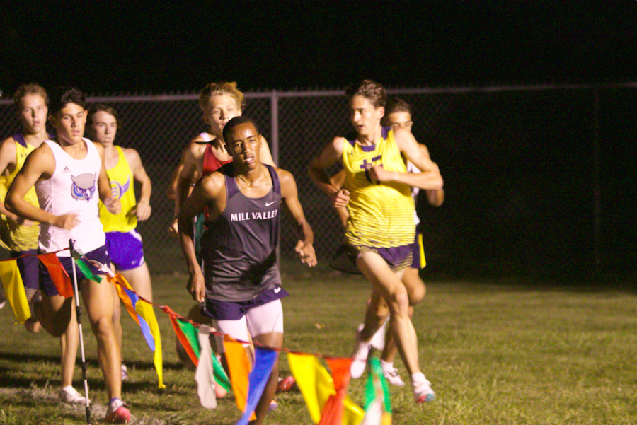 Sophomore AJ Vega starts the boys race on the front end of the pack. Vega went on to place fifth breaking his own school record with a 5K time of 15:28.