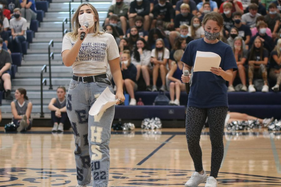 Microphones in hand, seniors Elise Canning and Lauren Walker announce at the Homecoming pep assembly held Friday Sept. 24.