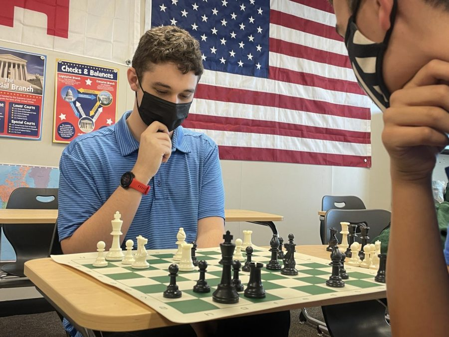 Thinking carefully, senior Colin Keltner and junior Isaac Steiner plan out their next moves