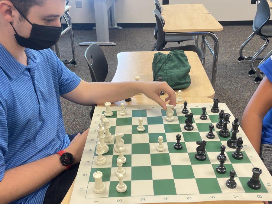 Senior Colin Keltner grabs his knight, deciding where it should go