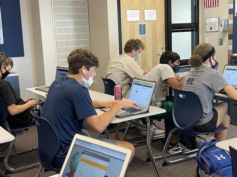 On Monday, September 20th, Juniors Yahel Anderson-Gonzalez, Finn Campbell, Gagan Biswa, and Mallory Botts are working on their survey and Xello lessons during seminar.