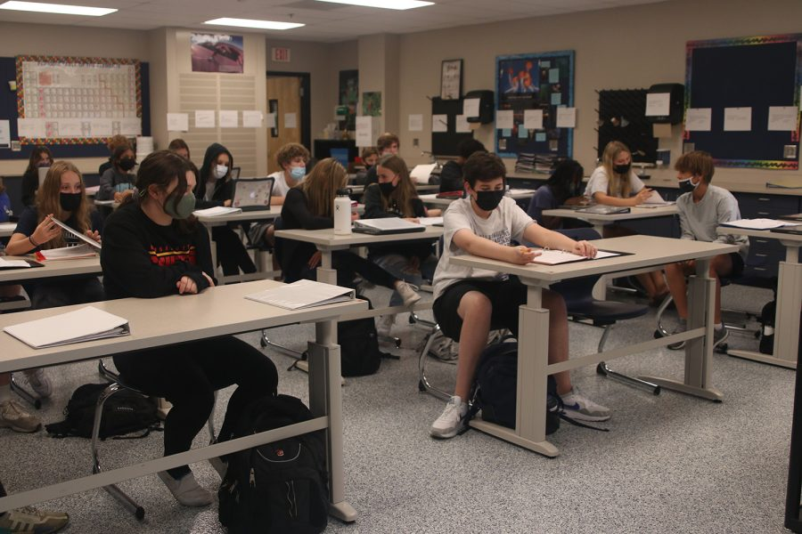 In a classroom full of masked students, Tuesday Oct. 19 will be the last day full masking is required by the Board of Education for high school students.