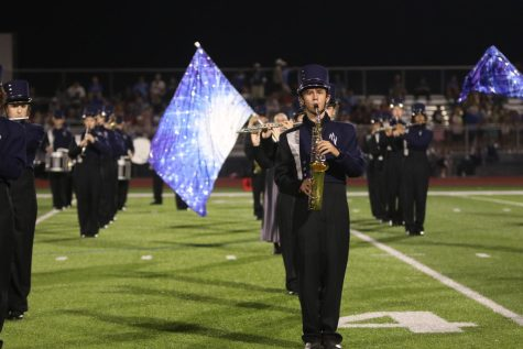 Senior Fischer Unruh stands in line with the rest of his section during the first movement of the marching show