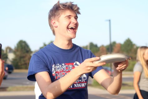 After catching the pancake on his plate, senior Bret Weber begins to cheer.