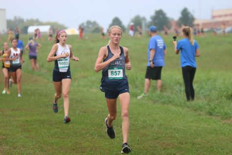 Freshman Charlotte Caldwell continues on after reaching the halfway point of the 3.1 mile race. Caldwell went on to take 16th place with a time of 19:25.
