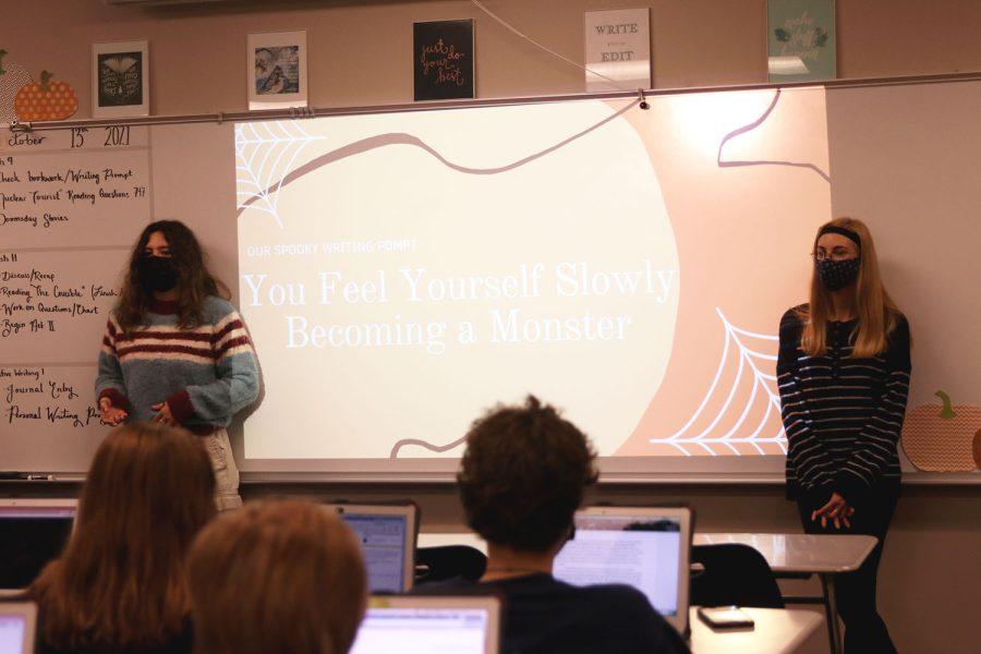 Presenting last weeks writing prompt, seniors Allison Rader and Ellie Basgall discuss how to share their stories with the club Wednesday, Oct. 13.