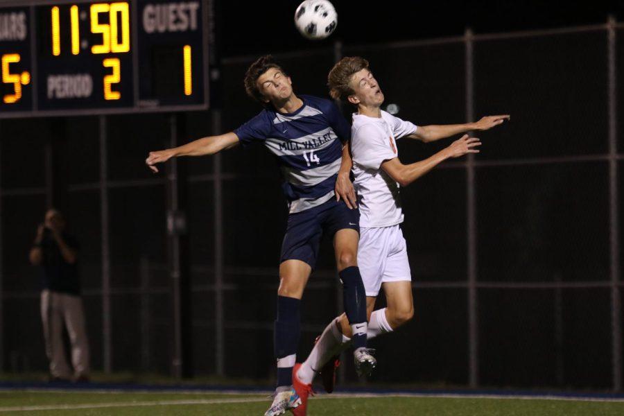 Jumping up, senior Brooks Scheelk goes in for a header.